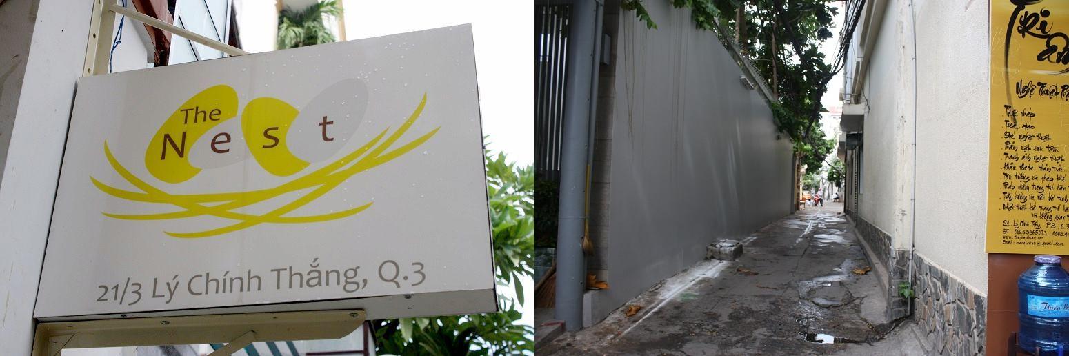 「The Nest」の看板と路地入口